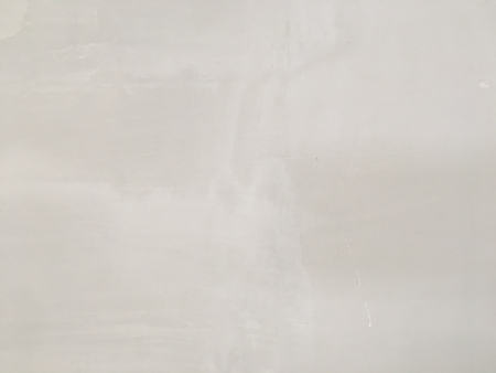 Grungy painted wall texture as background. Cracked concrete vintage wall background, old white painted wall. Background washed painting