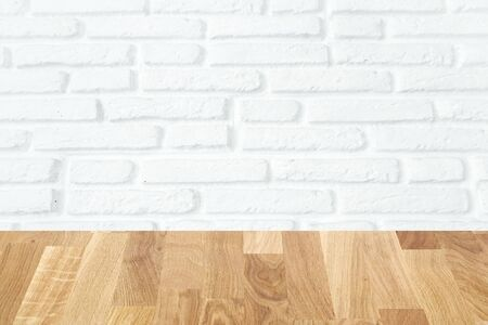 light brown wooden planks as a wood table or parquet floor in perspective, isolated on white brick wall