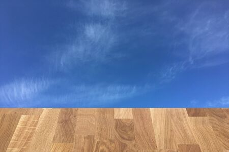 light brown wooden planks as a wood table or parquet floor in perspective, isolated on blue sky or white clouds