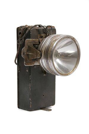 Old metal flashlight of batteries photo
