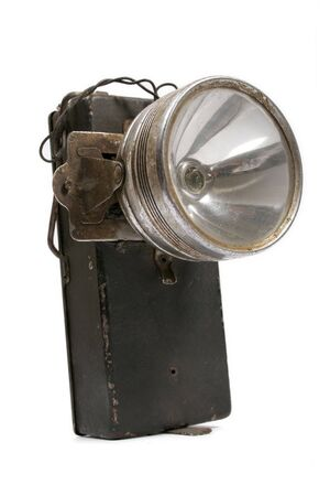 Old metal flashlight of batteries photo