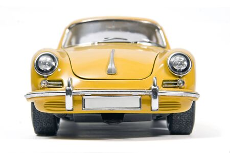 Yellow classical sports car toy photo