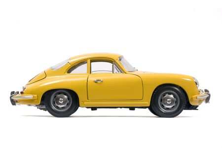 Yellow classical sports car toy