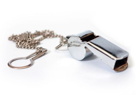 arbiter: Metal whistle with chain to hang up Stock Photo
