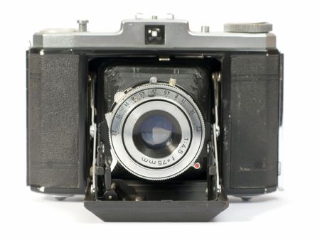 Old photographic camera with lens of bellows photo