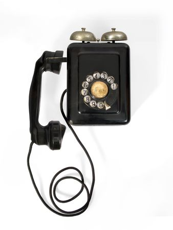 Old telephone in the wall fact with bakelite Stock Photo