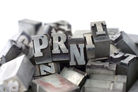 Printers blocks with the word PRINT. Upper case letters. Stock Photo