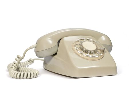 Old dial telephone in beige color. Stock Photo