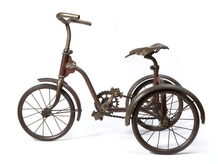 oldie: Old and rust iron tricycle.