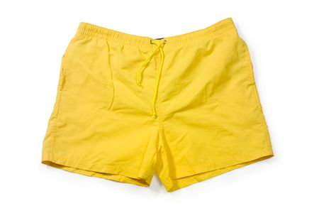 holidaying: Yellow swimming trunks isolated on white.