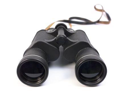 Black binoculars on white background. photo