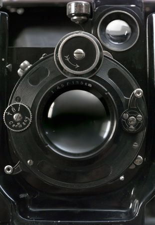 Old photographic camera with lens of bellows. Front view. Stock Photo