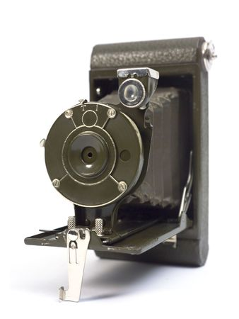 oldie: Old photographic camera with lens of bellows. Stock Photo