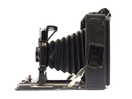old macro: Antiguo c�mara fotogr�fica con lente de fuelle. Vista lateral.