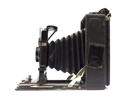 old camera: Old photographic camera with lens of bellows. Side view.