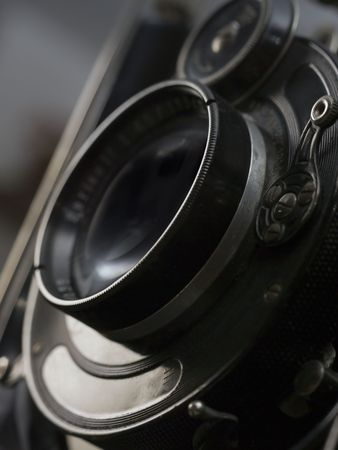 Old photographic camera with lens of bellows. Stock Photo