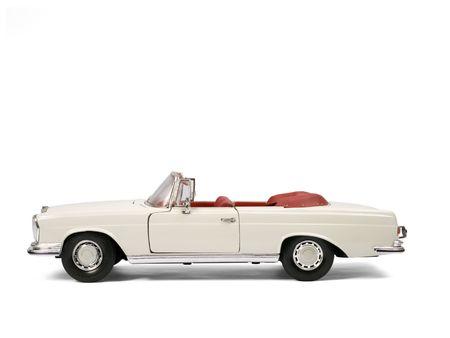 carritos de juguete: Cl�sica coche de lujo modelo de juguete. Vista lateral.