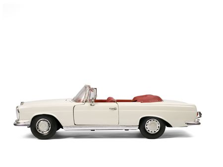Classical luxury car model toy. Side view. Stock Photo