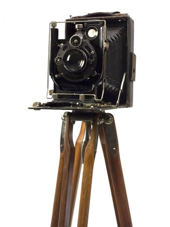 Old photographic camera with lens of bellows on wood tripod. Stock Photo - 2989556