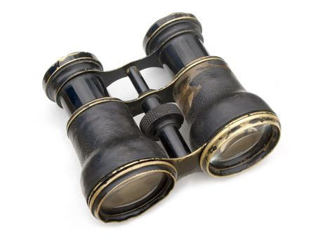 Old black binoculars isolated on white background.
