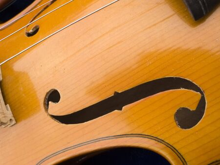 oldie: Old wood violin close-up. Stock Photo