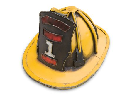 fireman helmet: Old yellow fireman helmet isolated on white. Stock Photo