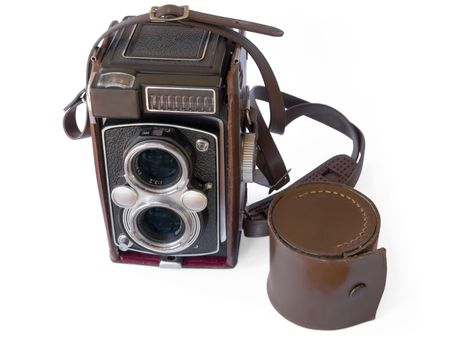 oldie: Old photographic camera with two lens. Isolated on white.