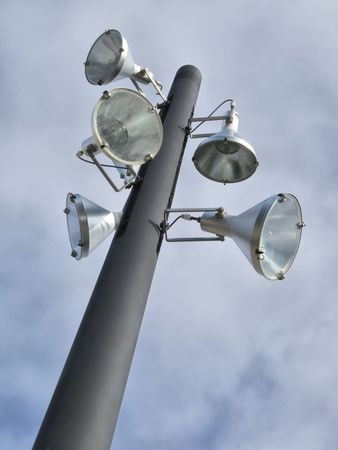 halogen lighting: Lamppost with floodlights in park. Stock Photo