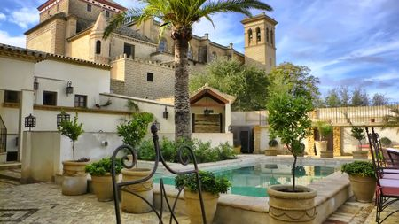 overlooking: Hotel in Osuna, Sevilla, Spain overlooking a monastery.