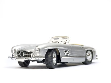 Classical sport car model toy. Side view. Stock Photo