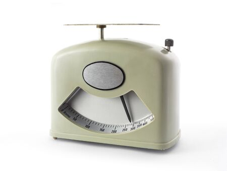 kilograms: Old weight scale isolated on white.