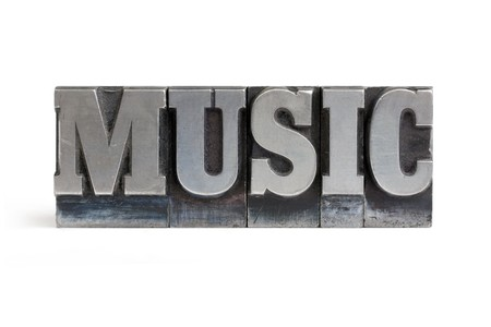Isolated printers blocks letters forming the word music. Stock Photo