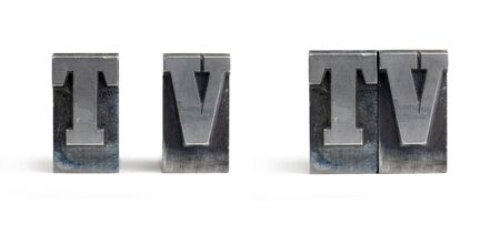 Isolated printers blocks letters forming the word television.