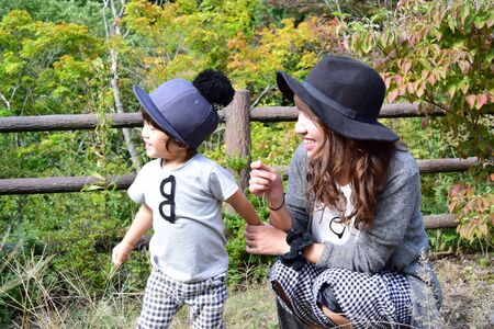 young japanese mother is playing with her son Foto de archivo