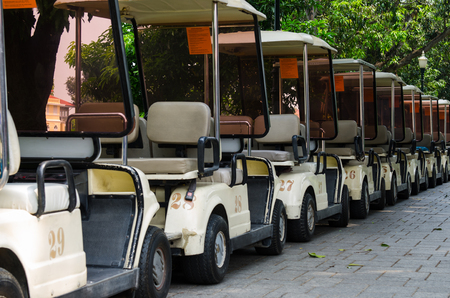 There are golf car parking photo