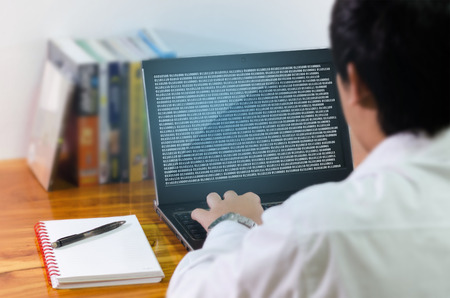 Programmer coding in the computer.