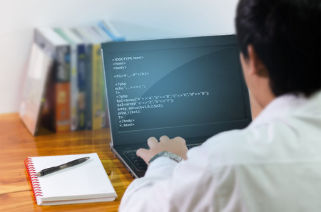 programmer computer: Programmer coding in the computer.
