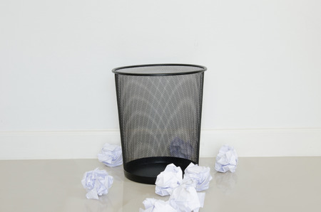wastepaper out the recycle bin on the floor Stock Photo