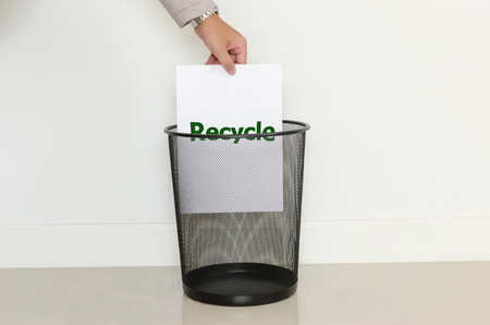 useless: Business man drop a useless paper in to the trash