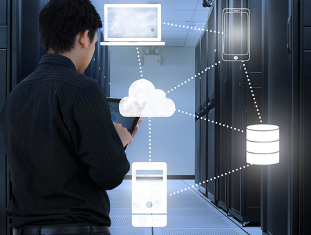 Business man working in data center with cloud technology