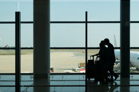 go inside: Silhouette walking in termanal airport