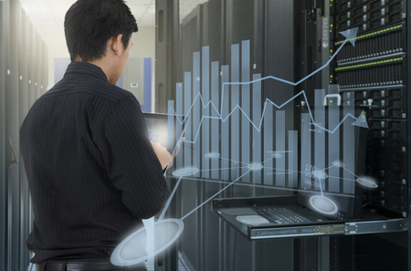 Man working in data center and use tablet for analyze system