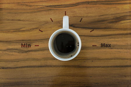 gage: Cup of coffee and gage volume concept on wooden table
