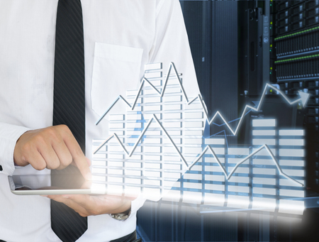 fileserver: Business man use tablet for analyze in data center Stock Photo