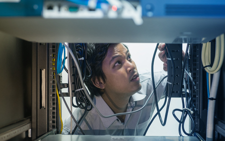 onsite: Man troubleshooting in data centre Stock Photo