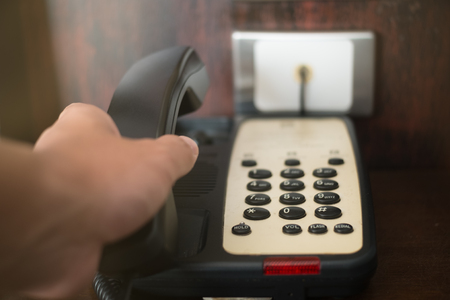 dial pad: Hand hang up hotel telephone