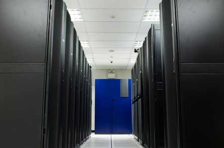 Server room with black Rack and blue Air condition Stock Photo