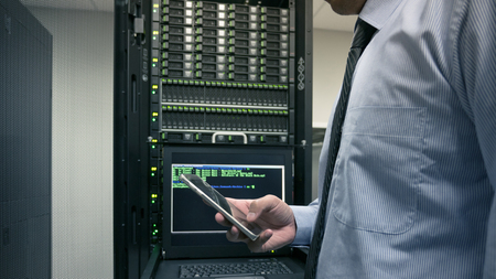 close up man use smart phone in data center Stock Photo