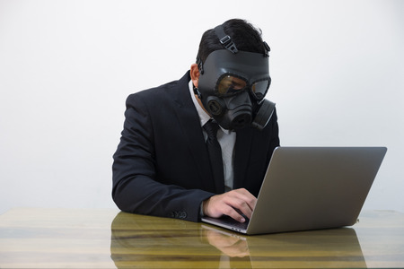 Hacker man in suit and toxic mask Imagens