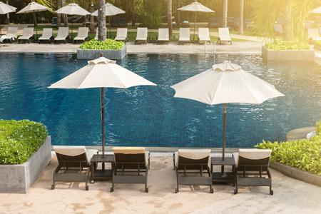 pool bed near swimming pool in resort.